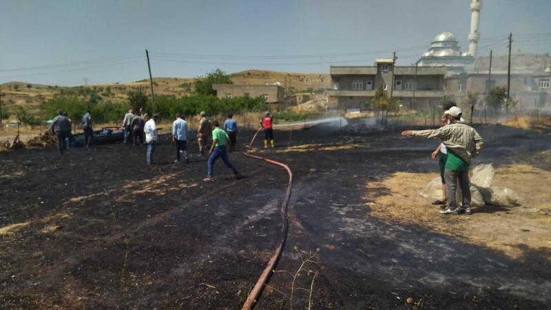 Kurtalan'da otluk alandaki yangın büyümeden söndürüldü
